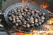 Roasting chestnuts on the barbecue fire