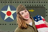 A Pretty Young Woman In Ww2 Uniform Us With American Flag poster
