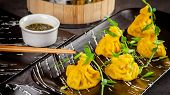 Pan-asian Cuisine Concept. Wontons Of Yellow Dough, Minced Meat. Japanese Dumplings With Minced Meat poster
