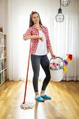Woman Holding A Floor Wiper And Bucket Filled With Mops And Cleaning Supplies, Doing House Work And  poster