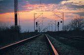 Sunset On The Railroad Tracks Landscape. Traveling By Train On Railroad In Sunset. Railroad Tracks L poster