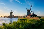 Netherlands rural lanscape Windmills at famous tourist site Zaanse Schans in Holland. Zaandam, Nethe poster