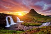 Majestic view of the awesome Kirkjufell volcano at sunset. Location place Kirkjufellsfoss waterfall, poster