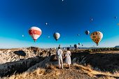 Couple In Love Among Balloons. Loving Couple Rear View. Couple In Love In Cappadocia. Couple In Turk poster