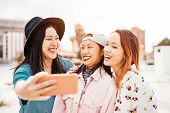 Happy Asian Girls Taking Selfie With Mobile Smartphone Outdoor - Young Trendy Teenager Having Fun Wi poster