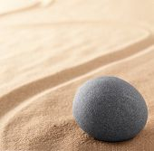 Zen stone garden for spiritual healing. Meditation and concentration sand background with copy space poster
