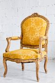 Vintage luxury Yellow sofa Armchair in vintage room
