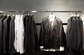 Row of suits in shop