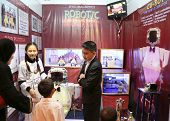 SUBANG JAYA - NOVEMBER 10: Unidentified high students from the Philippines explain their robotic pro