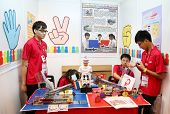 SUBANG JAYA - NOV 10: Unidentified students from Hong Kong build a robot that allow people to play a