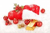 The red boot from Santa Claus in the snow, filled with christmas presents, ornaments and a gold