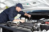 picture of internal combustion  - Professional car mechanic working in auto repair service - JPG