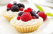 tartlets with fruits and berries