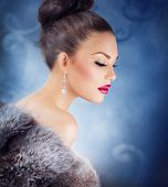Winter Girl in Luxury Fur Coat. Fashion Fur. Jewelry. Jewellery. Luxury Christmas Woman Portrait.Bea