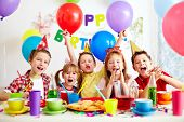 stock photo of adolescent  - Group of adorable kids having fun at birthday party - JPG