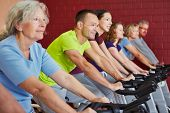 Spinning class exercising in a fitness center