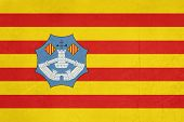 Grunge illustration of Minorca flaf of Balearic Islands, Spain, isolated on white background.