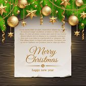 Christmas illustration - paper banner with greeting and Christmas tree branches with golden decorati