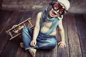 stock photo of time flies  - Small boy playing - JPG