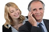 stock photo of unawares  - Woman admiring her boss - JPG