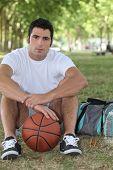 Basketball player sitting