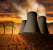 Sunset over the nuclear power plant with wind turbines