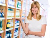 Happy Woman Presenting at a wine store