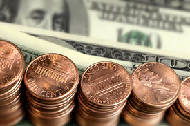 picture of one hundred dollar bill  - close up pile of American One Cents and 100 dollar - JPG