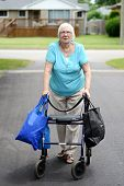 senior woman and walker overloaded with shopping bags
