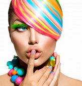 Beauty Girl Portrait with Colorful Makeup, Hair, Nail polish and Accessories. Colourful Studio Shot of Funny Surprised Woman. Vivid Rainbow Colors. Manicure and Hairstyle. Isolated on White