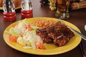 foto of baby back ribs  - Barbecued baby back ribs with baked beans salad and beer - JPG