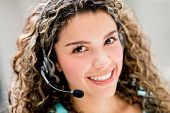 stock photo of telemarketing  - Customer service operator looking very friendly and smiling - JPG