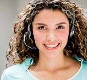 Happy woman with a headset - telemarketing agent concepts