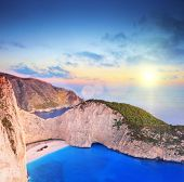 Panoramic view of Zakynthos island, Greece with a shipwreck on the sandy beach, at sunset, shot with a tilt and shift lens
