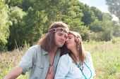 Couple Young Hippie On The Meadow