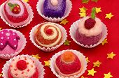 a christmassy assortment of colorful felt pralines
