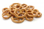 a pile of crispy pretzels on white background, american snack