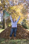 Raking Leaves Triumphant Girl