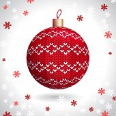 picture of knitting  - Red Knitted Christmas Ball on the Background of Snowflakes Knitted - JPG