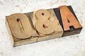 questions and answers i- Q&A acronym - text in vintage letterpress wood type on a ceramic tile backg