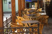 Street Cafe With Wicker Chairs In Morning