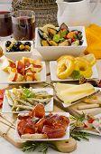 Spanish Cuisine. Variety Of Tapas On White Plates.