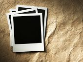 polaroid style photo frames on cardboard