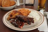 stock photo of baby back ribs  - Barbecue chicken and baby back ribs with baked beans and coleslaw - JPG