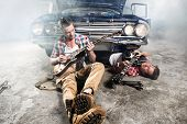 image of guitarists  - Guitarists at a garage next to the retro car in smoke - JPG