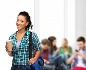 education, technology and people concept - smiling female african american student with bag and take