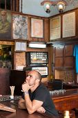 HAVANA,CUBA -JANUARY 20,2014:Tourist drinking at La Bodeguita del Medio.This restaurant was a favori