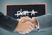 Composite image of business handshake against plan a and plan b written on a blackboard