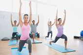 picture of pilates  - Sporty class doing pilate exercises in the fitness studio - JPG