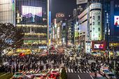 TOKYO, JAPAN - DECEMBER 15, 2012: Pedestrians cross at Shibuya Crossing. The intersection is known a
